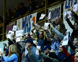 McDONALD, OHIO - FEBRYARY 6, 2018: Fans hold up 1000 point papers after Zach Rasile hit a three point shot to surpass 1000 in his career during the first half of their game on Tuesday night at McDonald High School. DAVID DERMER   THE VINDICATOR