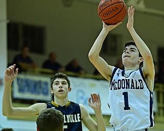 McDONALD, OHIO - FEBRUARY 6, 2018: McDonald's Zach Rasile shoots over Lowellville's Alex Mamula-Zarlingoduring the second half of their game on Tuesday night at McDonald High School. DAVID DERMER   THE VINDICATOR