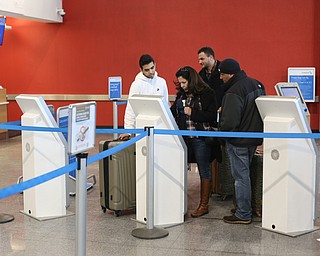 Fidaa Musleh(center) checks into her American Airlines flight, Wednesday, Feb. 7, 2018, at Cleveland Hopkins International Airport in Cleveland. ..(Nikos Frazier | The Vindicator)