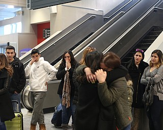Family members watch as Fidaa Mushleh hugs her daughter Rania Adi goodbye before departing for her flight to reunite with her husband, Al Adi in Amman, Jordan, Wednesday, Feb. 7, 2018, at Cleveland Hopkins International Airport in Cleveland. Adi was deported to Jordan last week after 13 days in ICE detainment...(Nikos Frazier | The Vindicator)