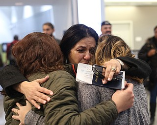 Fidaa Musleh(center) hugs her daughters, Rania(left) and Lina Adi goodbye before departing for her flight to reunite with her husband, Al Adi in Amman, Jordan, Wednesday, Feb. 7, 2018, at Cleveland Hopkins International Airport in Cleveland. Adi was deported to Jordan last week after 13 days in ICE detainment...(Nikos Frazier | The Vindicator)
