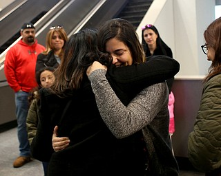 Fidaa Musleh(left) hugs her daughter, Lina Adi goodbye before departing for her flight to reunite with her husband, Al Adi in Amman, Jordan, Wednesday, Feb. 7, 2018, at Cleveland Hopkins International Airport in Cleveland. Adi was deported to Jordan last week after 13 days in ICE detainment...(Nikos Frazier | The Vindicator)
