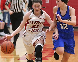 Columbiana's Taylor Hall (23) charges past Jackson-Milton guard Courtney Mercer (12) in the fourth quarter of an OHSAA high school basketball game, Thursday, Feb. 8, 2018, in Columbiana. Columbiana won 36-23...(Nikos Frazier | The Vindicator)