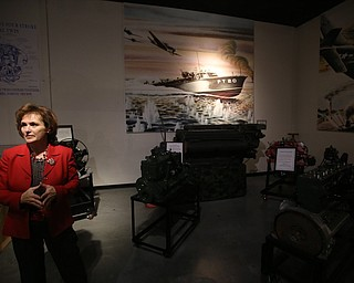 Executive Director Mary Ann Porinchak talks about the PT Boat engines, Wednesday, Jan. 24, 2018, at the Packard Museum in Warren...(Nikos Frazier | The Vindicator)