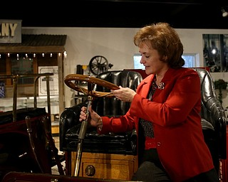 """Executive Director Mary Ann Porinchak moves the steering column on a Transcontinental Packard """"Old Pacific II"""" 1903 Model F 1 Cylinder 12 HP, Wednesday, Jan. 24, 2018, at the Packard Museum in Warren...(Nikos Frazier 