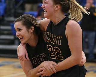 Garfield's Ashlun Geddes (4) and Garfield's Makenna Lawrence (22) celebrate after defeating Valley Christian 64-58, Saturday, Feb. 10, 2018, in Youngstown...(Nikos Frazier | The Vindicator)