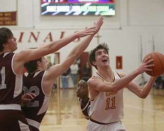 ROBERT  K. YOSAY   THE VINDICATOR..Boardmn at Cardinal Mooney ..Mooney #11Anthony fire andBoardman 21 Com Kreps and #32 Conner Miller as he puts in two during first quarter action