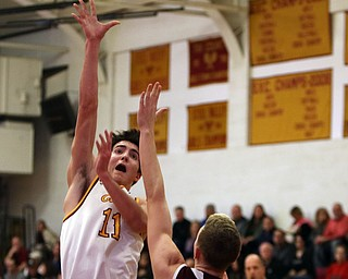ROBERT  K. YOSAY   THE VINDICATOR..Boardmn at Cardinal Mooney ..Mooney #11 Anthony Fire up and over   #3 Holden Lipke during first quarter action at Mooney