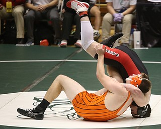 Canfield 285 pound wrestler Daniel Kapalko is flipped over by Claymont 285 pound wrestler Lyle Clark in the quarter finals of the OHSAA State Wrestling Dual Team Tournament, Sunday, Feb. 11, 2018, at Ohio State University's St. John Arena in Columbus...(Nikos Frazier | The Vindicator)