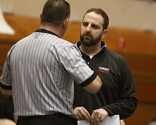 Canfield head coach Stephen Pitts talks with an official during Wauseon 120 pound wrestler Alex Slattman and Canfield 120 pound wrestler Nick Barber bout in the semi finals of the OHSAA State Wrestling Dual Team Tournament, Sunday, Feb. 11, 2018, at Ohio State University's St. John Arena in Columbus...(Nikos Frazier | The Vindicator)