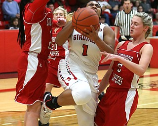 Struthers' Khaylah Brown (1) goes between Columbiana's Kennedy Fullum (15) and Columbiana's Tessa Liggett (5) for a layup in the first quarter of an OHSAA high school basketball game, Monday, Feb. 12, 2018, in Struthers. Struthers won 61-52...(Nikos Frazier | The Vindicator)