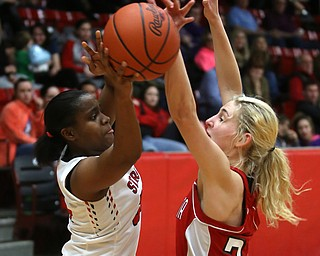 Struthers' Keasia Chism (34) looks for an open teammate as Columbiana's Alexis Cross (20) blocks her in a corner in the first quarter of an OHSAA high school basketball game, Monday, Feb. 12, 2018, in Struthers. Struthers won 61-52...(Nikos Frazier   The Vindicator)