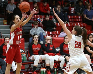 Columbiana's Grace Hammond (10) goes up for three as Struthers' Michelle Buser (22) attempts to block her shot in the second quarter of an OHSAA high school basketball game, Monday, Feb. 12, 2018, in Struthers. Struthers won 61-52...(Nikos Frazier | The Vindicator)