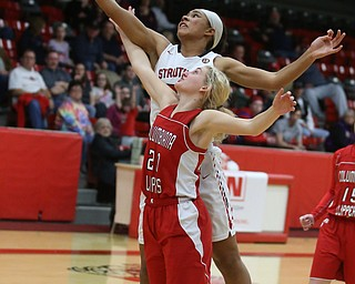 Struthers' Trinity McDowell (23) reaches past Columbiana's Alexis Cross (20) for the rebound in the third quarter of an OHSAA high school basketball game, Monday, Feb. 12, 2018, in Struthers. Struthers won 61-52...(Nikos Frazier | The Vindicator)