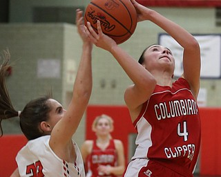 Columbiana's Kayla Muslovki (4)'s layup is blocked by Struthers' Michelle Buser (22) in the fourth quarter of an OHSAA high school basketball game, Monday, Feb. 12, 2018, in Struthers. Struthers won 61-52...(Nikos Frazier | The Vindicator)
