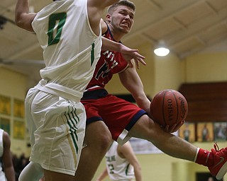 Austintown Fitch fowrard Kole Klasic (14) layup is blocked by Ursuline forward Devan Keevey (0) in the first quarter of an OHSAA high school basketball game, Tuesday, Feb. 13, 2018, in Youngstown. Ursuline won 63-58...(Nikos Frazier | The Vindicator)