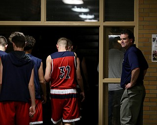 Austintown Fitch head coach Brian Beany yells at his players after the second quarter of an OHSAA high school basketball game, Tuesday, Feb. 13, 2018, in Youngstown. Ursuline won 63-58...(Nikos Frazier | The Vindicator)