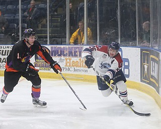Youngstown Phantoms forward Tommy Parottino (9) steals the puck from Central Illinois Flying Aces left wing Calen Kiefiuk (13)  in the second period of an USHL hockey game, Tuesday, Feb. 13, 2018, in Youngstown...(Nikos Frazier | The Vindicator)