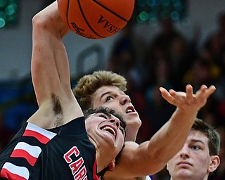 POLAND, OHIO - FEBRUARY 16, 2018: Canfield's Ben Shapiro grabs a rebound away from Poland's Mike Diaz during the second half of their game on Friday night at Poland Seminary High School. DAVID DERMER   THE VINDICATOR