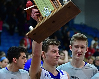"""POLAND, OHIO - FEBRUARY 16, 2018: Poland's Billy Orr celebrates with the """"Battle of 224"""" trophy after Poland defeated Canfield, Friday night at Poland Seminary High School. DAVID DERMER   THE VINDICATOR"""