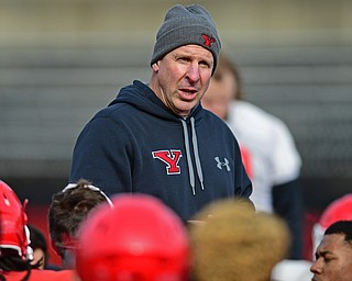 YOUNGSTOWN, OHIO - FEBRUARY 18, 2018: Youngstown State head coach Bo Pelini addresses the team after the teams practice on Sunday afternoon at Stambaugh Stadium. DAVID DERMER | THE VINDICATOR