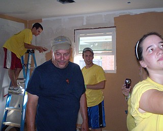 Painting the walls and installing cabinets