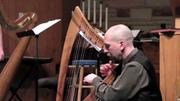 "Harpist Kirk Kupensky and vocalist Colleen McNally-Harris perform the traditional Celtic song ""The Castle of Dromore""."