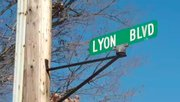 Lyon Blvd. in Poland Twp. is riddled with potholes. One resident describes the street as a war zone.