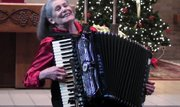 Betty Bannon has been playing the accordion for 75 of her 82 years and performed during a Christmas music program at St. Charles Church in Boardman today.