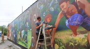 A Columbus artist is painting a mural in Youngstown's Idora neighborhood.