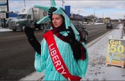 Dressed as The Statue Of Liberty a local woman hits the street with a special goal in mind.