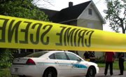 A woman holding a 5-month old child was shot to death at a Youngstown home today. The baby was unharmed.