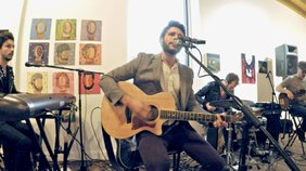 "JD Eicher performs the song ""Lines in the Sky"" at the Soap Gallery for ""The Middle Distance"" album release party."
