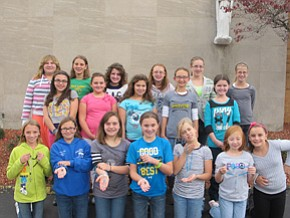 Holy Family students serve others
