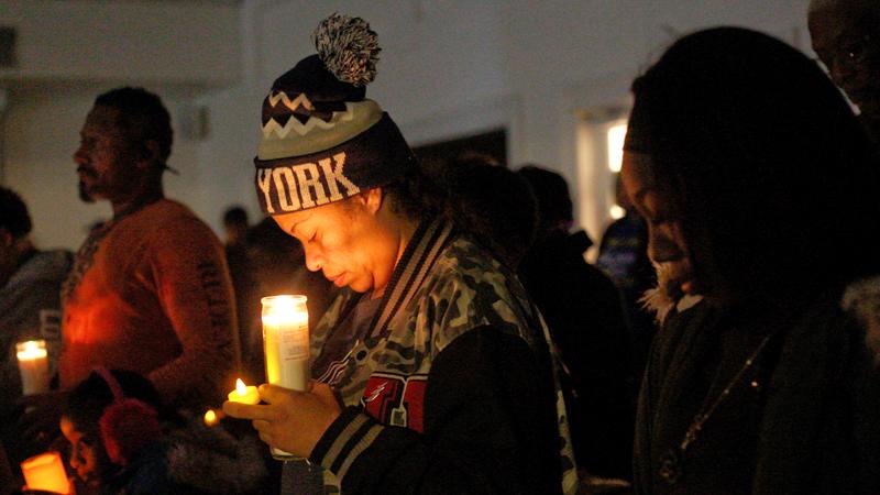 Prayer, song, lanterns honor 5 fire victims at Saturday vigil