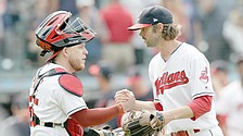 Tribe grand slam powers win over O's