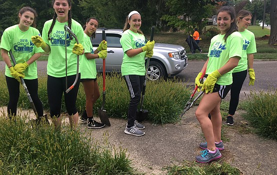 Students and staff spruce up the neighborhood