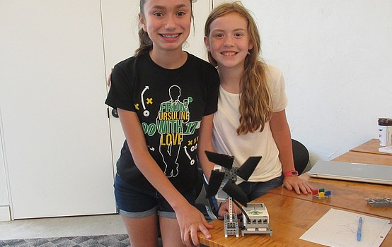 Middle school students create robots at the library