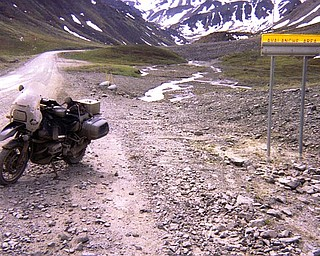 Sharp rocks capable of puncturing tires on the road to Prudhoe Bay. The Road is also spotted with signs warning travelers about possible avalanches.