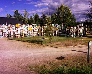 In Tok, Alaska, Dyckman came across this fence which is constructed entirely out of road signs.