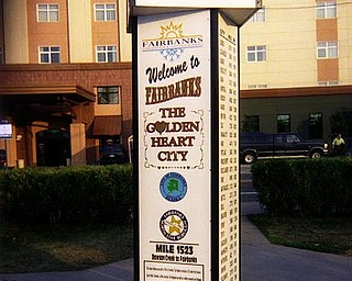 A park in Fairbanks, Alaska, has a marker indicating the distance to surrounding cities in miles and kilometers.