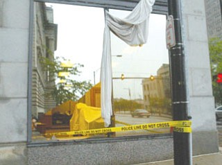 Winds ripped through windows on bank at Wick Avenue and West Boardman Street.