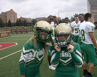 Ashley Williams (Left) & Kayla Spear (right) are ready to switch from cheerleaders to football players.
