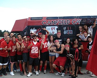 Canfield Seniors 08 rev it up in front of their spirit bus before the Alliance game.  The group raised the proceeds for the bus and worked countless hours on the project to express their school pride and spirit.