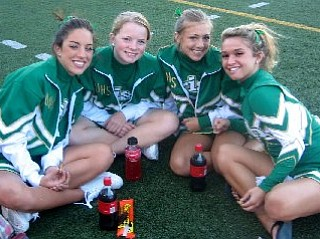 JoAnne Tombo, Kayla Spear, Ashley Williams and Annie Morris are pregaming before the game.
