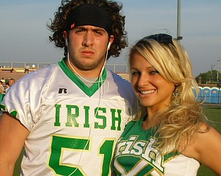 Ursuline Football Captain, Ryan Kelly and Cheerleading Captain, Katie Olenick, prepare for the game.