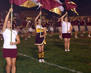 Melissa Williams, Whitney Gould, and Rachel Holisky are part of the flagline with the Raider Band.