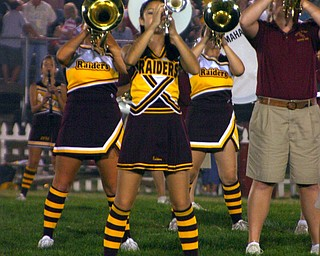 South Range Cheerleaders use half time to march in the Raider Band!