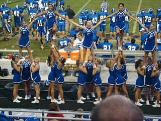 Poland Bulldog Cheerleaders perform the Liberty Stunt while cheering their team on to a 56-7 Victory