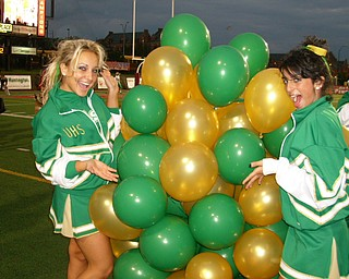 Ursuline Cheerleading Captain Katie Olenick and Cheerleader Cara Mia Ghatti have fun with Ursuline's green and gold balloons!